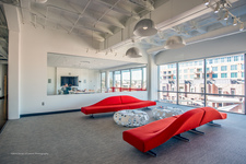 Red Sofas - Waiting  Room w/ window wall conference room and city view